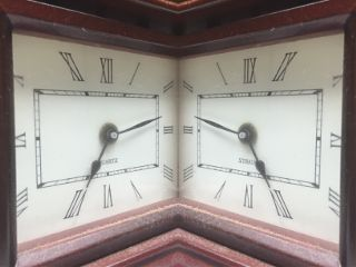 mirrored antique clock interesting