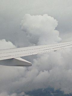 airplane flight clouds thunderheads ruthfeiertag