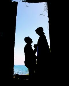 beach love silhouette engagement bride